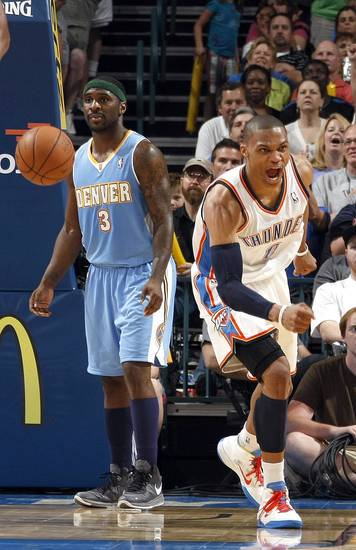 Oklahoma City's Russell Westbrook (0) celebrates a basket in front of Denver's Ty Lawson (3) during the NBA basketball game between the Oklahoma City Thunder and the Denver Nuggets, Friday, April 8, 2011, at the Oklahoma City Arena.. Photo by Sarah Phipps, The Oklahoman