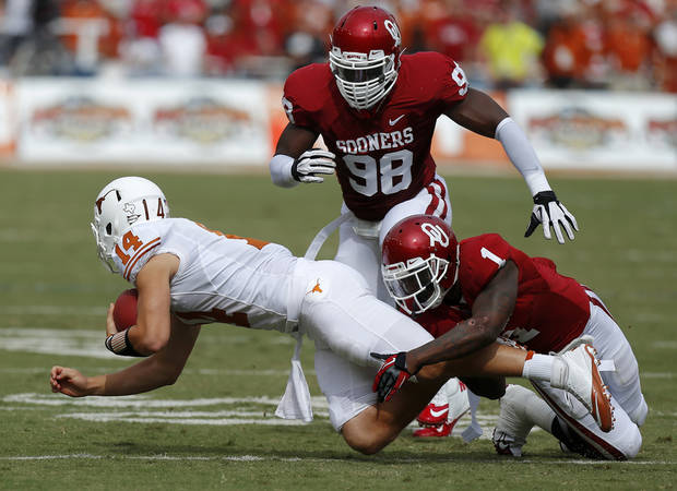 OU's Tony Jefferson (1) and Tony Jefferson (1) bring down UT's David Ash (14) during the Red River Rivalry college football game between the University of Oklahoma (OU) and the University of Texas (UT) at the Cotton Bowl in Dallas, Saturday, Oct. 13, 2012. Photo by Bryan Terry, The Oklahoman