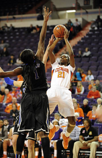 Clemson's Nikki Dixon (21) shoots a jumper over Duke's Elizabeth Williams during the second half of an NCAA college basketball game, Thursday, Jan. 24, 2013, at Littlejohn Coliseum in Clemson, S.C. Duke won 60-46. (AP Photo/Richard Shiro)