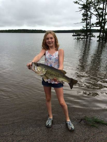 Megan Fleck of Blanchard caught this largemouth bass May 28 in the parking lot of McGee Creek Lake. The parking lot was underwater from the flood.