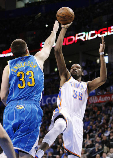 New Orleans Hornets forward Ryan Anderson (33) defends as Oklahoma City Thunder forward Kevin Durant (35) shoots during the second quarter of an NBA basketball game in Oklahoma City, Wednesday, Feb. 27, 2013. (AP Photo/Alonzo Adams)