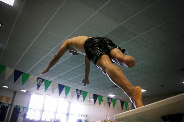 UNIVERSITY OF CENTRAL OKLAHOMA / SWIMMING: Anil Gurung from the UK dives off the blocks during a practice for the Endeavor Games at UCO's Hamilton Field House in Edmond on Thursday, June 9, 2011. Photo by Zach Gray, The Oklahoman ORG XMIT: KOD