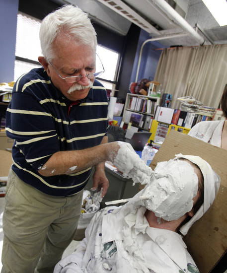 Mateo Pettyjohn has a face cast made by Artist-in-Residence Patrick Riley at Harding Fine Arts Academy in Oklahoma City, Thursday, February  16,  2012. The students are making a DNA sculpture for a Respect Diversity Foundation's annual competition. Photo By Steve Gooch, The Oklahoman