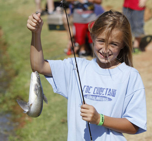 Eleven year old Ashley Leighty shows off her fish during a fishing derby at Little River Park in Moore, OK, Saturday, August 4, 2012,  By Paul Hellstern, The Oklahoman