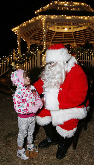 Isabella Anderson, 4, talks with Santa Claus at the University of Oklahoma's holiday lights celebration at David A. Burr Park on campus. PHOTO BY STEVE SISNEY, THE OKLAHOMAN <strong>STEVE SISNEY</strong>