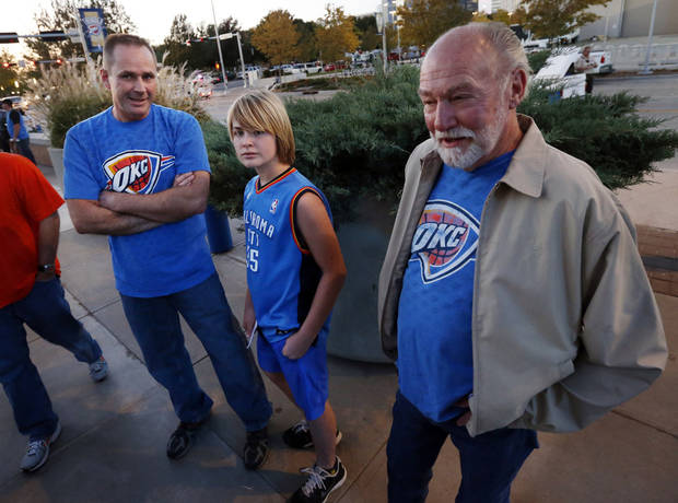 Ronnie and Jake Peacock and Ronnie's father-in-law Jim Boling, all from Edmond, wait outside the arena as the Oklahoma City Thunder play the Portland Trail Blazers in NBA basketball at the Chesapeake Energy Arena in Oklahoma City, on Friday, Nov. 2, 2012.  Photo by Steve Sisney, The Oklahoman