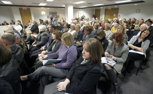ANNOUNCE / ANNOUNCEMENT / RETIRE: The meeting room is filled as DHS Director Howard Hendrick announces his retirement during a meeting of the Department of Human Services at the Sequoyah Memorial Office Building in Oklahoma City, OK, Tuesday, Jan. 24, 2012. By Paul Hellstern, The Oklahoman