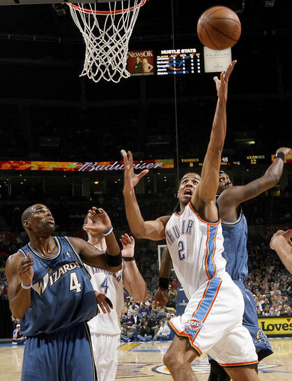 Oklahoma City's Thabo Sefolosha moves to the basket between Washington's Antawn Jamison, left, and Dominic McGuire during the NBA basketball game between the Oklahoma City Thunder and the Washington Wizards at the Ford Center in Oklahoma City, Wed., March 4, 2009. PHOTO BY BRYAN TERRY, THE OKLAHOMAN