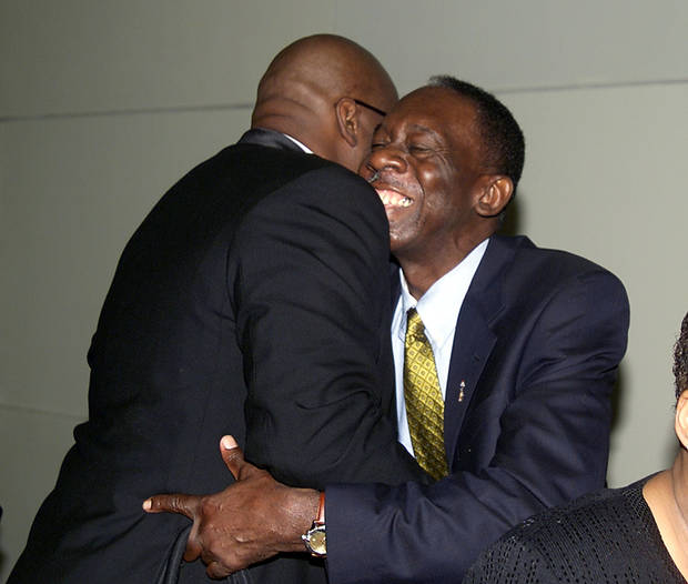 "INDUCT, INDUCTION: Inductee Wayman Tisdale greets Hubert ""Geese"" Ausbie before the Oklahoma Sports Hall of Fame banquet at the National Cowboy and Western Heritage Museum. Staff photo by Paul Hellstern"