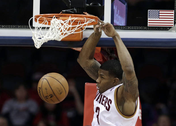 Cleveland Cavaliers' Alonzo Gee dunks the ball in the first quarter of an NBA basketball game against the Minnesota Timberwolves Monday, Feb. 11, 2013, in Cleveland. (AP Photo/Tony Dejak)