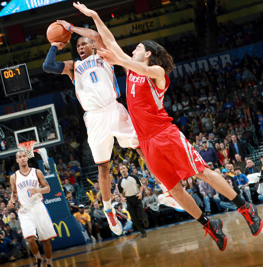 With 0.7 left on the clock for the first half, Oklahoma City's Westbrook is fouled by  Houston's Luis Scola during their NBA basketball game at the OKC Arena in downtown Oklahoma City on Wednesday, Nov. 17, 2010. Photo by John Clanton, The Oklahoman