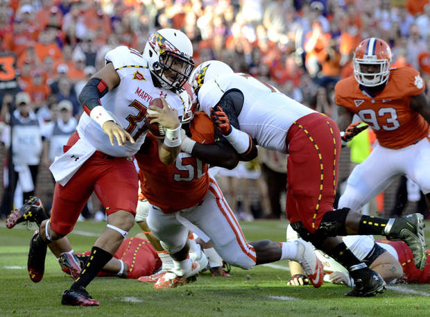 Maryland quarterback Shawn Petty rushes out of the pocket during the first half of an NCAA college football game against Clemson on Saturday, Nov. 10, 2012, at Memorial Stadium in Clemson, S.C.(AP Photo/Richard Shiro)
