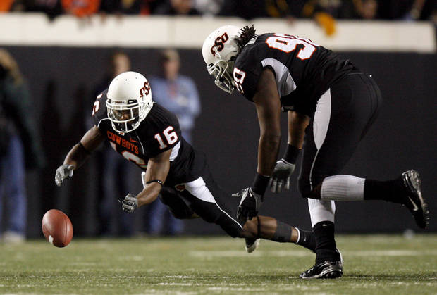 OSU&#039;s Perrish Cox (16) recovers a fumble as Swanson Miller (90) looks on during the college football game between Oklahoma State University (OSU) and the University of Colorado (CU) at Boone Pickens Stadium in Stillwater, Okla., Thursday, Nov. 19, 2009. Photo by Sarah Phipps, The Oklahoman