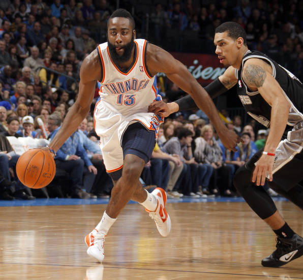 Oklahoma City Thunder's James Harden (13) dribbles by San Antonio Spurs' Daniel Green (4) during the the NBA basketball game between the Oklahoma City Thunder and the San Antonio Spurs at the Chesapeake Energy Arena in Oklahoma City, Sunday, Jan. 8, 2012. Photo by Sarah Phipps, The Oklahoman