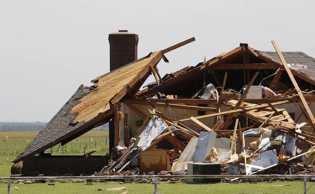 Damaged home in Union City on Saturday, June 1, 2013, from last night's tornado.   Photo  by Jim Beckel, The Oklahoman.