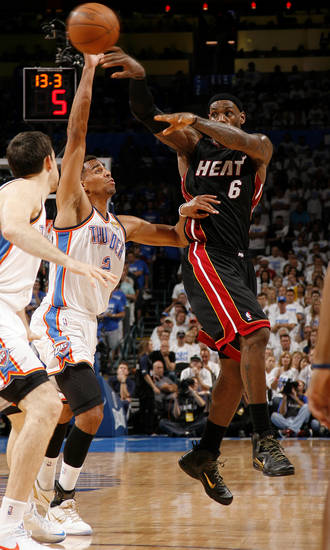 Miami's LeBron James (6) passes the ball over Oklahoma City's Thabo Sefolosha (2) during Game 2 of the NBA Finals between the Oklahoma City Thunder and the Miami Heat at Chesapeake Energy Arena in Oklahoma City, Thursday, June 14, 2012. Photo by Sarah Phipps, The Oklahoman