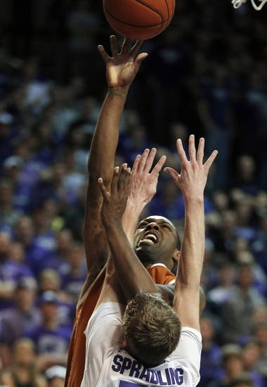 Kansas State guard Will Spradling, front, catches an elbow on the nose by Texas guard Sheldon McClellan (1) during the first half of an NCAA college basketball game in Manhattan, Kan., Wednesday, Jan. 30, 2013. (AP Photo/Orlin Wagner)