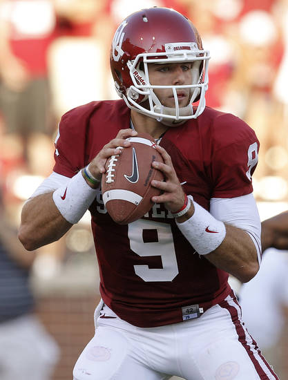 Oklahoma's Trevor Knight (9) drops back to pass during a college football game between the University of Oklahoma Sooners (OU) and the University of Louisiana Monroe Warhawks at Gaylord Family-Oklahoma Memorial Stadium in Norman, Okla., on Saturday, Aug. 31, 2013. Photo by Bryan Terry The Oklahoman
