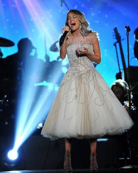 """Checotah native Carrie Underwood performs on """"ACM Presents: An All-Star Salute to the Troops."""" AP photo"""