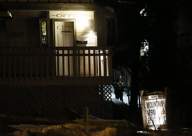 Investigators work near the Mountain View Resort in Big Bear, Calif., near where where authorities believe ex-Los Angeles police officer Christopher Dorner barricaded himself inside, engaged in a shootout that killed a deputy and then never emerged as the home went up in flames, Tuesday, Feb. 12, 2013. (AP Photo/Los Angeles Times, Robert Gauthier)  NO FORNS; NO SALES; MAGS OUT; ORANGE COUNTY REGISTER OUT; LOS ANGELES DAILY NEWS OUT; VENTURA COUNTY STAR OUT; INLAND VALLEY DAILY BULLETIN OUT; MANDATORY CREDIT, TV OUT