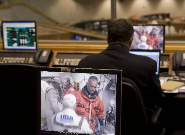 "In this photo provided by  NASA, astronaut John ""Danny"" Olivas is seen preparing to board the space shuttle Discovery at pad 39a on a monitor in Firing Room Four of the Kennedy Space Center at Cape Canaveral, Fla., Monday, Aug. 24, 2009. (AP Photo/Bill Ingalls)"