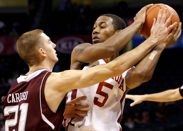COLLEGE BASKETBALL TOURNAMENT / OU: Oklahoma's Je'lon Hornbeak  looks to pass the ball as A&M's Alex Caruso defends during the All-College Classic between the University of Oklahoma and Texas A&M at the  Chesapeake Energy Arena in  Oklahoma City, Saturday,Dec. 15, 2012. Photo by Sarah Phipps, The Oklahoman