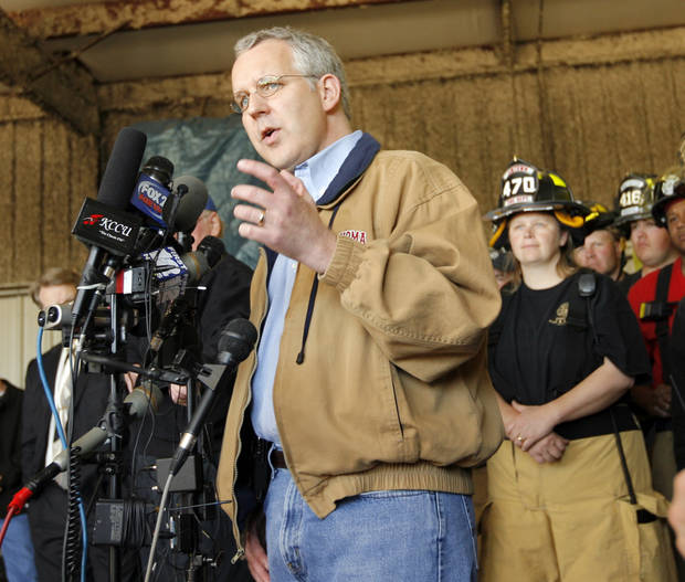Gov. Brad Henry gives a news conference surrounded by first responders at the Lone Grove Fire Station No. 1 in Lone Grove, Okla., Wednesday, February 11, 2009. On Tuesday, February 10, 2009, a tornado moved through Lone Grove killing at least eight people. BY NATE BILLINGS, THE OKLAHOMAN