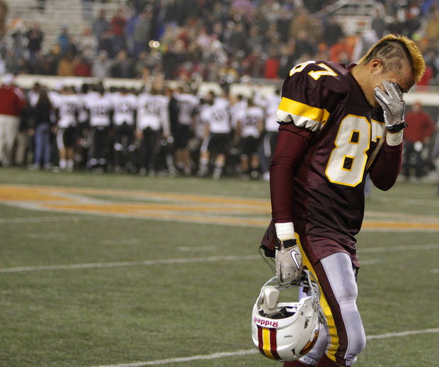Clinton's Ben Perez walks off the field after losing to Wagoner 23-0 in the class 4A state championship high school football game at Boone Pickens Stadium  in Stillwater, Okla., Friday, Dec. 2, 2011. Photo by Bryan Terry, The Oklahoman