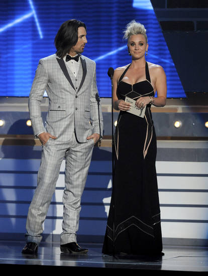 Actress Kaley Cuoco, right, and singer Jake Owen present the award for vocal group of the year at the 48th Annual Academy of Country Music Awards at the MGM Grand Garden Arena in Las Vegas on Sunday, April 7, 2013. (Photo by Chris Pizzello/Invision/AP) ORG XMIT: NVPM272