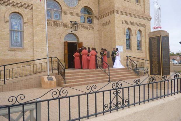 Members of a wedding party wait for the processional to begin at the Basilica of San Albino in Mesilla, N.M. PHOTO BY KIMBERLY BURK, THE OKLAHOMAN <strong></strong>