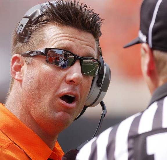 Coach Mike Gundy talks with an official during the college football game between OSU and the University of Georgia at Boone Pickens Stadium on the campus of Oklahoma State University in Stillwater Saturday, Sept. 5, 2009. Photo by Doug Hoke, The Oklahoman. ORG XMIT: KOD