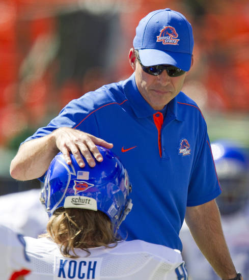 Boise State head coach Chris Petersen pats tight end Chandler Koch (88) on the helmet during warm-ups before their NCAA college football game against Hawaii on Saturday, Nov. 10, 2012, in Honolulu. (AP Photo/Eugene Tanner) ORG XMIT: HIET105