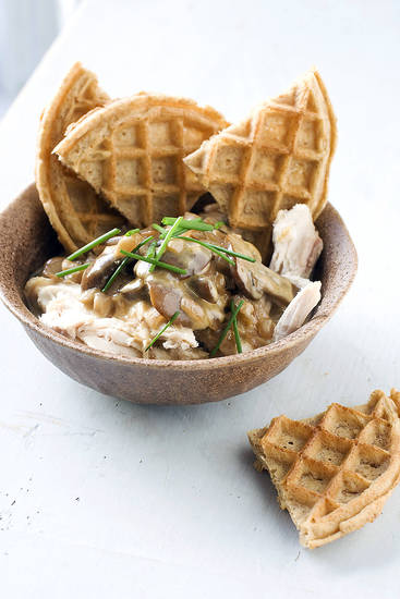 Rotisserie chicken with waffles and gravy is seen served in a bowl. AP Photo/Matthew Mead <strong>Matthew Mead - AP</strong>