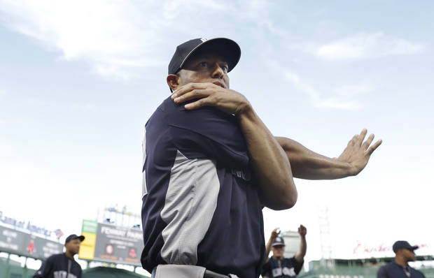 New York Yankees relief pitcher Mariano Rivera stretches before a baseball game against the Boston Red Sox at Fenway Park, in Boston, Sunday, Sept. 15, 2013. (AP Photo/Steven Senne)