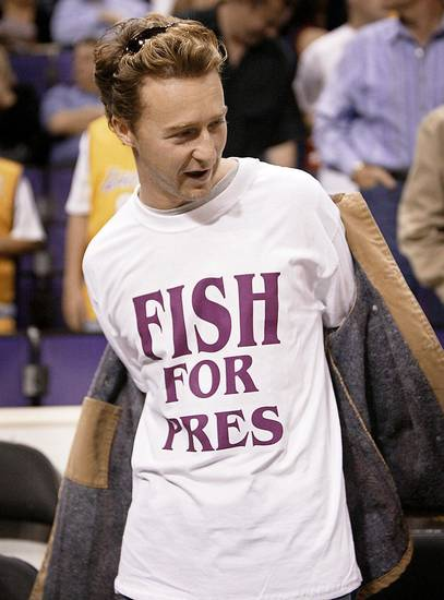 Actor Edward Norton wears a t-shirt supporting Los Angeles Lakers guard Derek Fisher before the start of Game 6 of the Lakers' NBA Western Conference semifinal game against the San Antonio Spurs in Los Angeles, Saturday, May 15, 2004. Fisher's Game 5 buzzer beater won the game for the Lakers. (AP Photo/Kevork Djansezian)