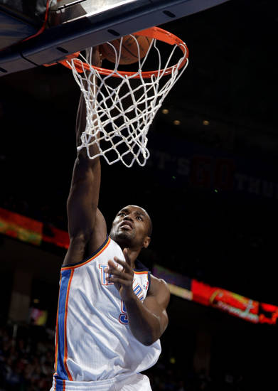 Oklahoma City's Serge Ibaka (9) dunks the ball during the NBA basketball game between the Oklahoma City Thunder and the Portland Trail Blazers at Chesapeake Energy Arena in Oklahoma City, Sunday, March 18, 2012. Photo by Sarah Phipps, The Oklahoman.
