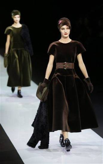 Models wear creations for Emporio Armani women's Fall-Winter 2013-14 collection, part of the Milan Fashion Week, unveiled in Milan, Italy, Sunday, Feb. 24, 2013. (AP Photo/Luca Bruno)