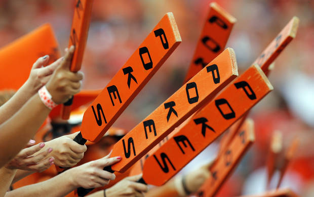 OSU fans wave paddles during the college football game between the University of Tulsa (TU) and Oklahoma State University (OSU) at Boone Pickens Stadium in Stillwater, Oklahoma, Saturday, September 18, 2010. Photo by Nate Billings, The Oklahoman