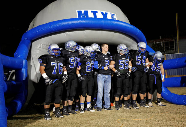 Guthrie players prepare to take the field before Friday's 48-0 win over Southeast. PHOTO BY BRYAN TERRY, THE OKLAHOMAN