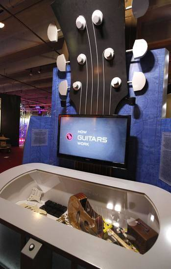 "Visitors can learn how guitars make music in the interactive traveling exhibit ""The Science of Rock 'n' Roll,"" on view at Science Museum Oklahoma. Photo by Paul Hellstern, The Oklahoman"