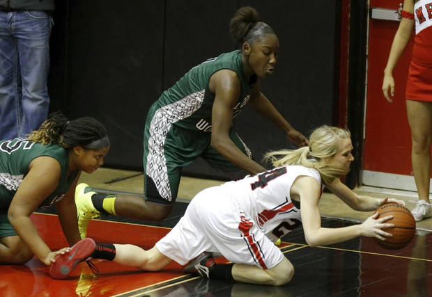 Edmond Santa Fe's Alaina Cooper, left, and Aahliyah Jackson go for the ball behind Mustang's Laci Joyner during a girls high school basketball game in Mustang, Okla., Tuesday, Jan. 15, 2013. Photo by Bryan Terry, The Oklahoman