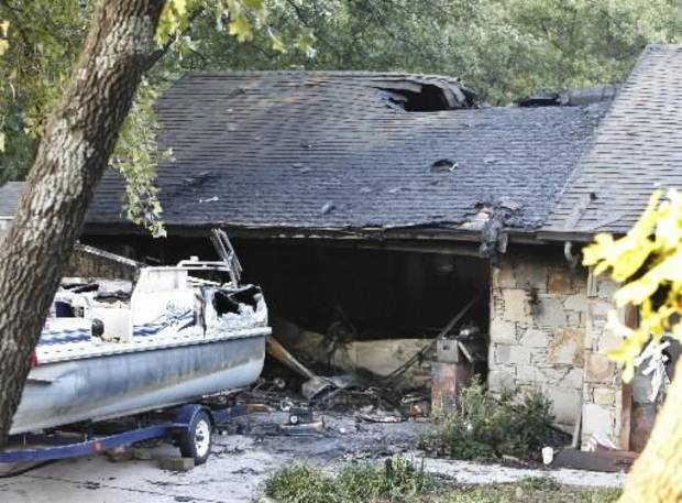 This home at 1716 Ridgecrest in Edmond, OK, Monday, was gutted by a late night fire. October 1, 2012. By Paul Hellstern
