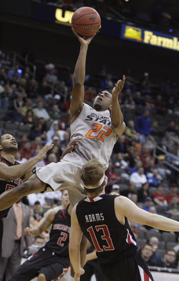 Oklahoma State's Markel Brown (22) shoots over Texas Tech's Luke Adams (13) during the Big 12 tournament men's basketball game between the Oklahoma State Cowboys and the Texas Tech Red Raiders at the Sprint Center, Wednesday, March, 6, 2012. Photo by Sarah Phipps, The Oklahoman