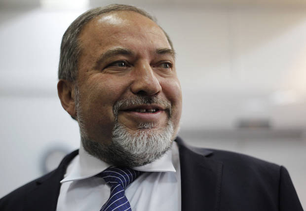 Israel's hard-line former Foreign Minister Avigdor Lieberman, arrives at a Jerusalem court for the opening hearing of his trial on charges of fraud and breach of trust, Sunday, Feb. 17, 2013. Lieberman is accused of trying to advance the career of a former diplomat who relayed information to him about a since-closed criminal investigation into his business dealings. (AP Photo/Ariel Schalit)