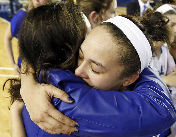 Deer Creek's Ashley Gibson (44), right, hugs head coach Totsy Manning after the Antlers won the Class 5A girls championship high school basketball game in the state tournament at the Mabee Center in Tulsa, Okla., Saturday, March 9, 2013. Deer Creek defeated Shawnee, 59-44. Photo by Nate Billings, The Oklahoman