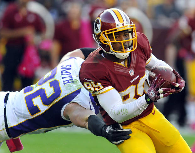 Minnesota Vikings safety Harrison Smith (22) tackles Washington Redskins wide receiver Santana Moss (89) during the first half of an NFL football game, Sunday, Oct. 14, 2012, in Landover, Md. (AP Photo/Richard Lipski)