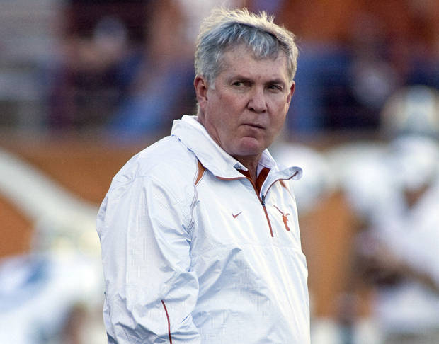 "Mack Brown told Jenni Carlson the ""coach-in-waiting"" decision in 2008 was a mistake. (AP Photo/Harry Cabluck, File)"