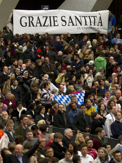 "Faithful hold a banner reading in Italian ""Grazie Santita' "" (Thank you Your Holiness) during Pope Benedict XVI's weekly general audience in the Paul VI Hall at the Vatican, Wednesday Feb. 13, 2013. Looking tired but serene, Pope Benedict XVI told thousands of faithful Wednesday that he was stepping down for ""the good of the church,"" speaking in his first public appearance since dropping the bombshell announcement of his resignation. The 85-year-old Benedict basked in more than a minute-long standing ovation when he entered the packed audience hall for his traditional Wednesday general audience. (AP Photo/Alessandra Tarantino)"