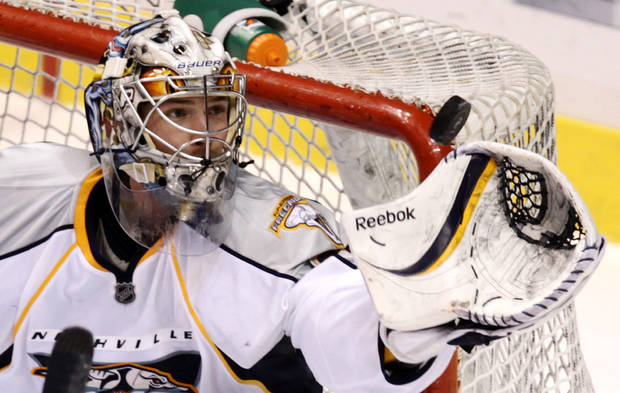 Nashville Predators goalie Pekka Rinne, of Finland, gloves the puck out of the air during the second period of an NHL hockey game against the Vancouver Canucks in Vancouver, Canada, on Wednesday Jan. 26, 2011. (AP Photo/The Canadian Press, Darryl Dyck)