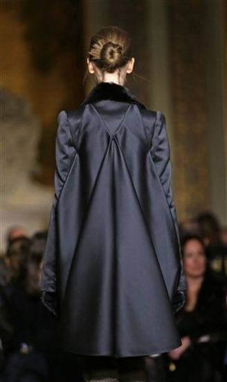 A model returns from the runway during the Zac Posen Fall 2013 show at Fashion Week at the Plaza in New York, Sunday, Feb. 10, 2013.  (AP Photo/Kathy Willens)